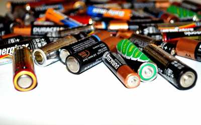 How should I dispose of batteries and lightbulbs?